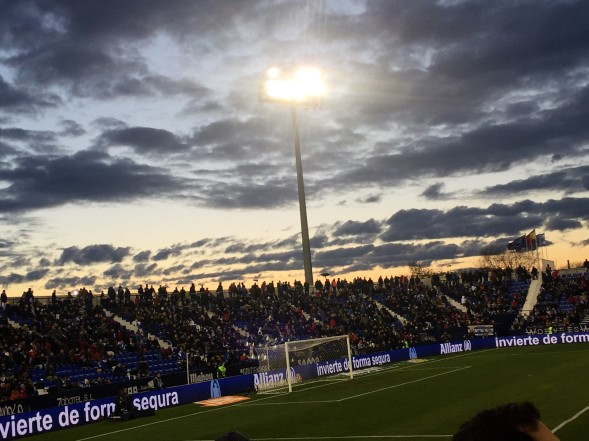 Leganes fans stand at the back of the stand to watch the end of the match as they leave the stadium.